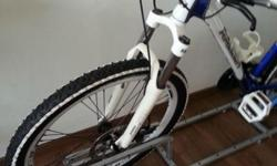 Very brand new as hardly used. Mountain bicycle with