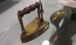 Very early about 1895-1910 Gold colour Iron. It is