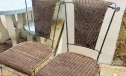 Two stylish rattan chairs. �Green Copper� looking metal