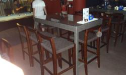 Rattan chairs and tables used by HD Sports Bar at