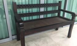 Selling a lovely dark brown teak bench with carvings in