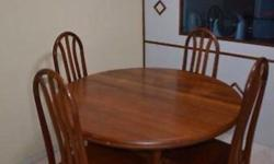 Wooden Dining Table. In good condition. converts from 4