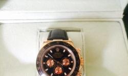 Rolex Daytona with leather strap. With Rolex box
