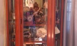 In very good condition display cabinet to be sold w/o