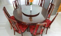 Elegant solid Rosewood dining table for 8 persons. This