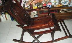 Rosewood Rocking chair,interested to view can contact
