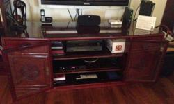 Rosewood TV cabinet. Well maintained. 6 feet wide,