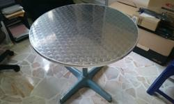 Round table with metal legs. approx 1m in diammeter.