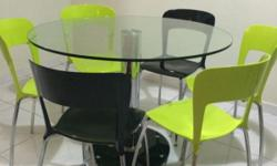 Round tempered glass dinning table with 6 chairs