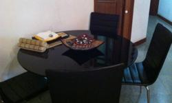 Round dining table with black coated glass too and 4