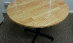 A simple round office table. Good as a discussion