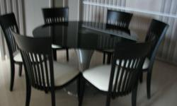 Round glass top dinning table with strong steel leg