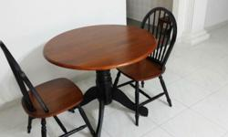 Almost new round table (fold down sides) with 2 chairs.