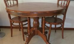 Letting go a round solid wooden table at low price.