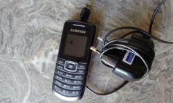 Samsung mobile phone and charger, includes battery.