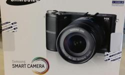 Brand new Samsung Smart Camera NX 210. Sealed in box.
