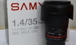 Samyung lens 35mm, F1.4 . Very seldom used. Very good