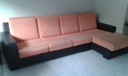 Seahorse L-shape sofa for sale. There are slight tear