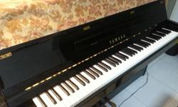 A 13 years old black piano yamaha is for sale including