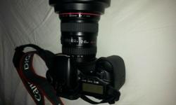 Sell Canon D30 SLR camera + lens at S$1300. Super