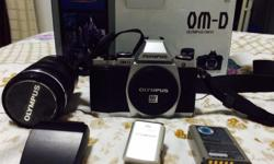 Selling 1 Olympus OM-D EM-5 (Silver Color) With 12-50mm