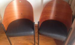 Set of wood w leather seat arm chairs. Hardly used look