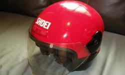 Selling away a used and vintage, red SHOEI original
