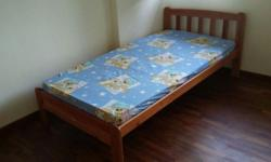 Single wooden bedframe with solid (not slatted) base