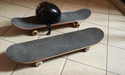 Selling two Skateboards with a helmet. Skateboards may