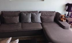 Preowned OM sofa. Excellent condition with a set of