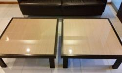 Two used solid timber Bali style tea tables with glass