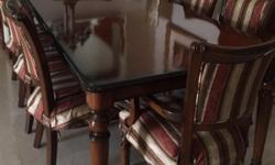Solid mahogany table and chairs for 8. Table in