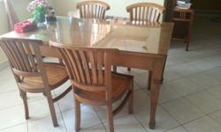 I'm selling solid wood dining table with four solid