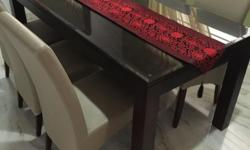Solid wood table with beveled glass top, very sturdy