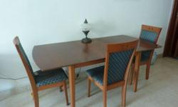 Hi, selling my solid wooden dining set due to