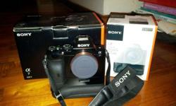 Selling a good working Sony A7 body with vertical grip.