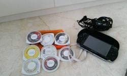 Sony PSP + 8 Games a few years old perfect conditions.