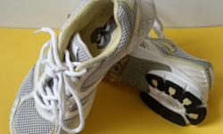 Stability Unisex white Sports shoes. Very light weight.