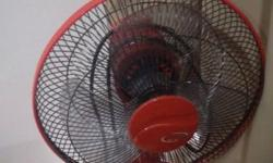 This is a red color fan. It is available immediately.