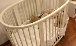 Stokke bed for baby with mini cot mattress and toddler
