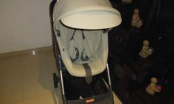 STOKKE SCOOT STROLLER -COLOR BEIGE -BOUGHT IN AUGUST