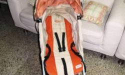 Hi am selling two strollers and child seat; 1.Orange