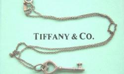 DESCRIPTION: Luxury T & Co. Tiffany & Company Designer