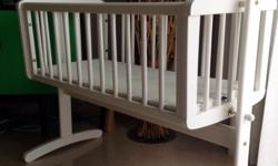 Swinging crib with mattress. Excellent condition . Used