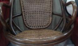 swivel rattan chair.walnut colour. $60. cash and carry