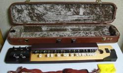 27-key, 5-string. Suzuki electric Taisho Koto Manner