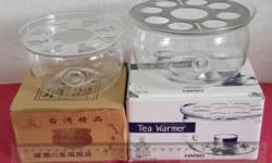 Brand new in box. Tea Warmer. The glass warmer can use