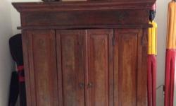 Teak cabinet bought at The Shophouse.