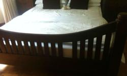 Solid teak Queen sized Slat Bed. Cost $3000. Selling