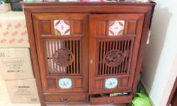 Teakwood Cabinet for sale Door opens and slides in (